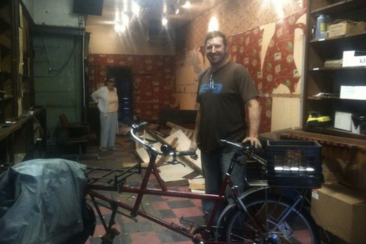 David Wilson (and a photobomber) in the soon-to-open shop. Image credit: Simon Firth
