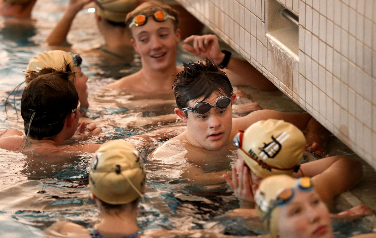 Lance Gillespie chats with his Davis High School teammates during practice in Layton on Friday, Dec. 4, 2020. Gillespie is captain of the varsity swim team.