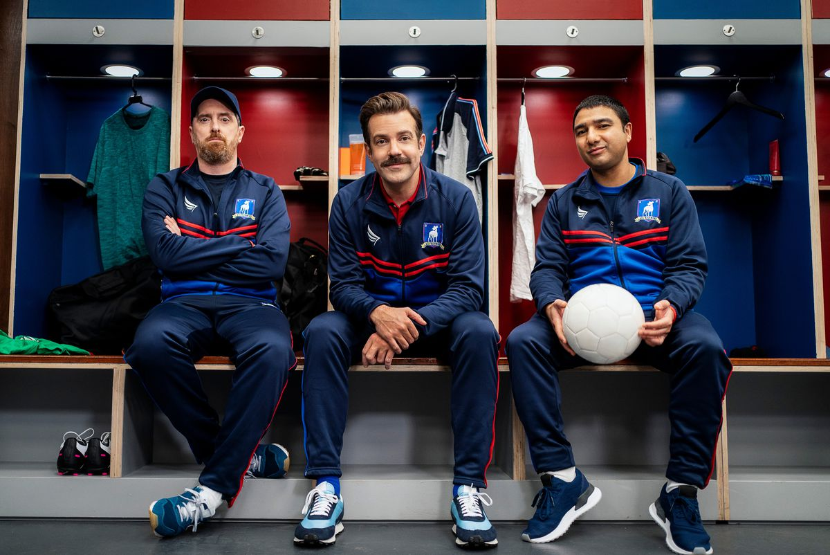 Jason Sudeikis on the bench in uniform in Ted Lasso