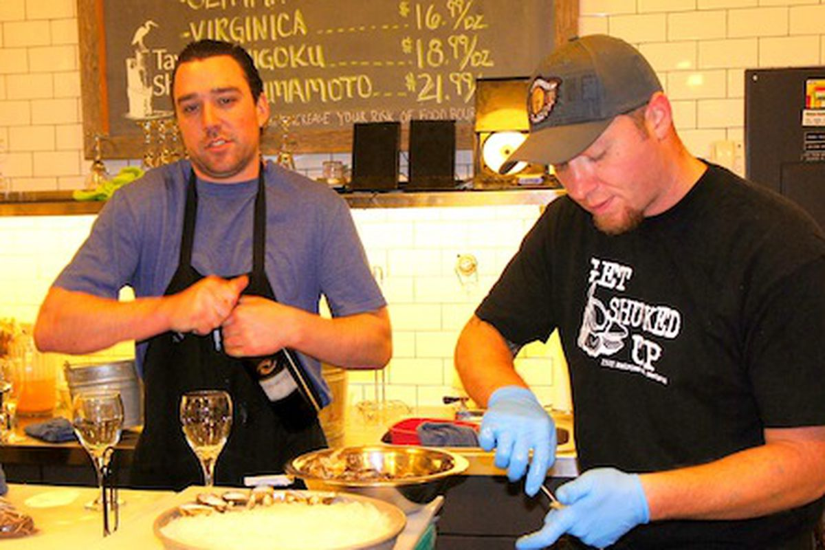 David Leck (right) shucks Virginicas with assistant manager Tom Stocks