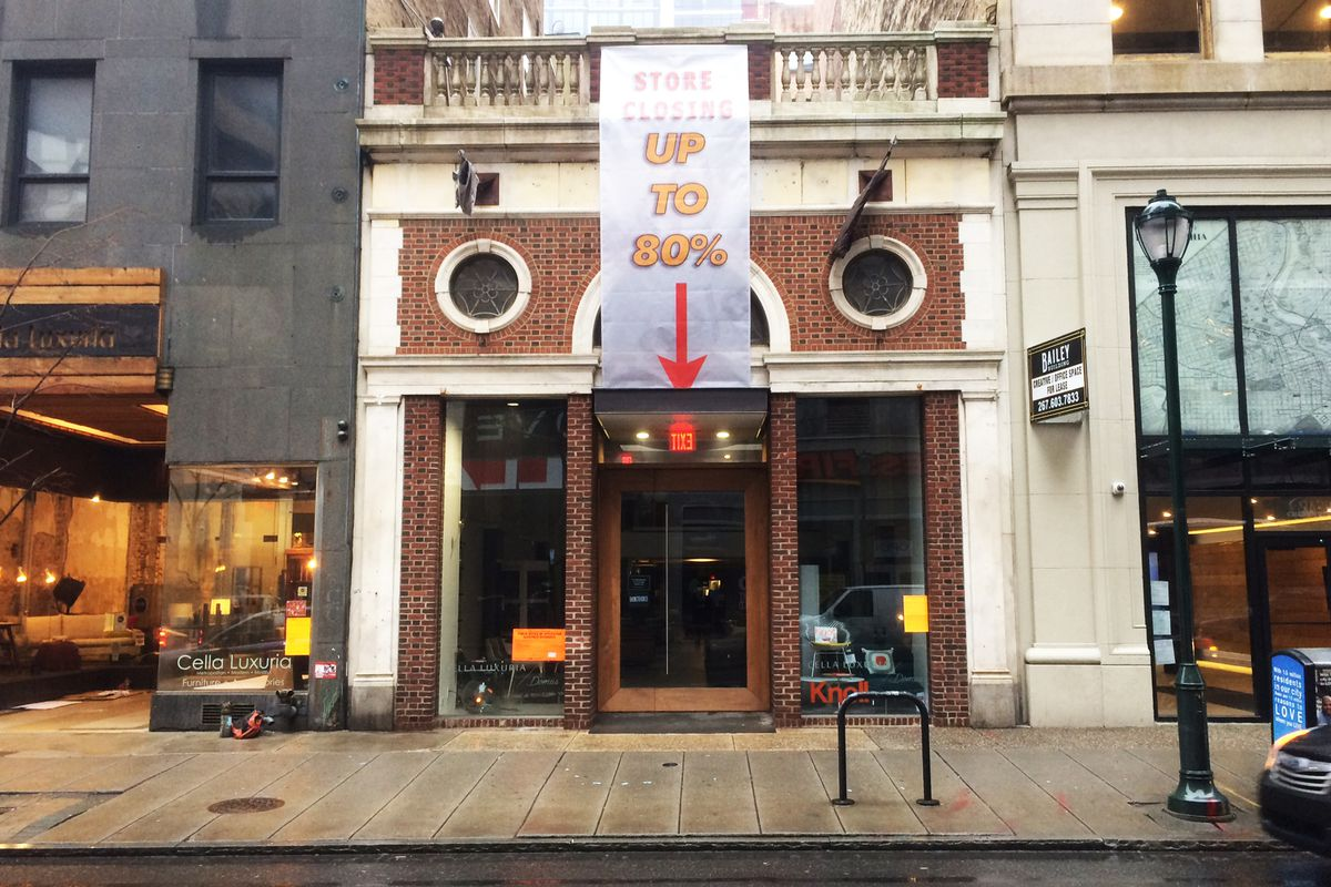 """A storefront in Philadelphia with a sign that says """"Store closing up to 80 percent off."""""""