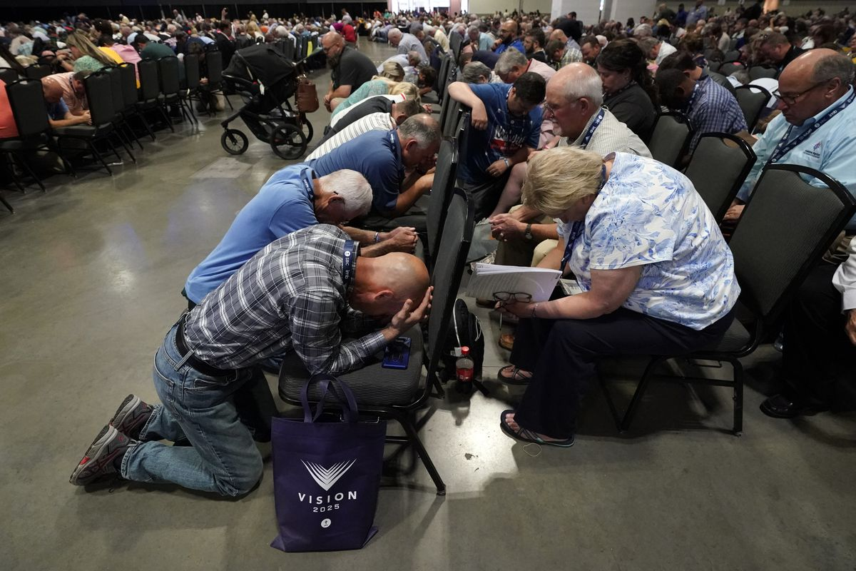 People pray during the annual Southern Baptist Convention meeting Tuesday, June 15, 2021, in Nashville, Tenn.