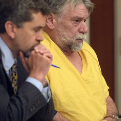 """Defense attorney Mike Sikora, left, and Patrick Michael McCabe, 60, right, listen to proceedings during McCabe's sentencing before 3rd District Judge Paul Parker in Salt Lake City on Wednesday, June 7, 2017. McCabe pleaded guilty to first-degree felony counts of murder and aggravated burglary in the December 1977 slaying of 16-year-old Sharon """"Lecia"""" Schollmeyer at her Salt Lake apartment."""