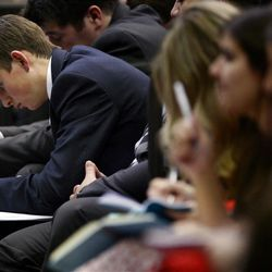 A missionary takes notes during the Christmas Morning Devotional at the Missionary Training Center in Provo on Tuesday, Dec. 25, 2012.