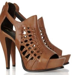 """<b>Elizabeth and James</b> braided leather sandals, <a href=""""http://www.theoutnet.com/product/219859"""">$75</a> (were $375)."""