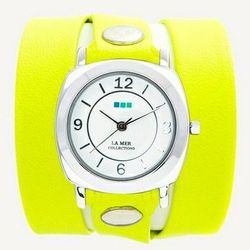 """<a href=http://www.lamercollections.com/collection/REFINERY-29-EXCLUSIVE-Neon-Yellow-Silver-Odyssey-Wrap/""""> La Mer Collection Odyssey wrap watch</a>, $98 lamercollections.com"""