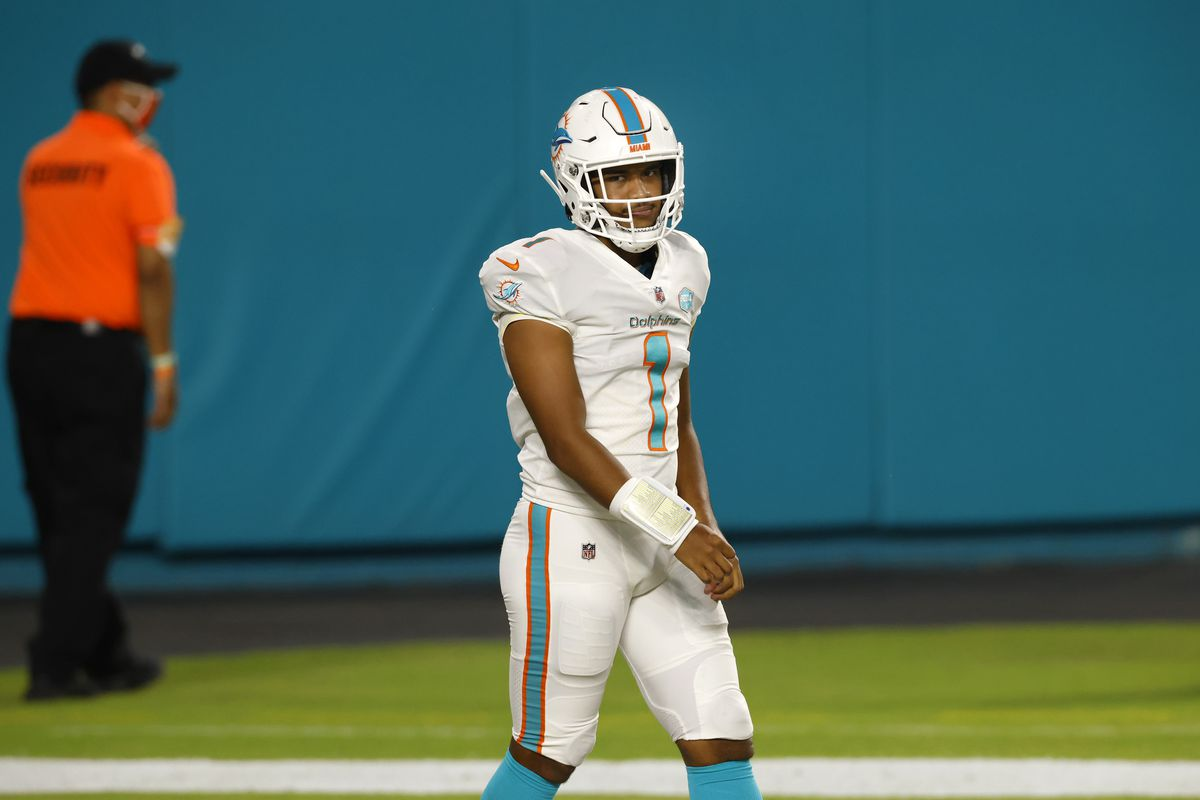 Quarterback Tua Tagovailoa #1 of the Miami Dolphins looks on after making his first career complete pass during the second half of their game against the New York Jets at Hard Rock Stadium on October 18, 2020 in Miami Gardens, Florida.