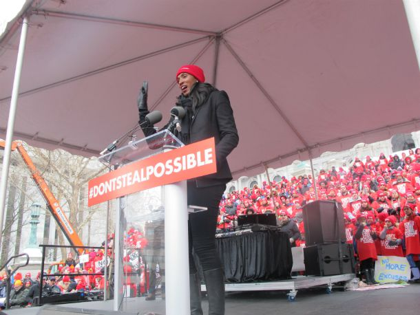 Olympic gold medalist and WNBA star Lisa Leslie addresses the crowd at Wednesday's rally organized by charter school advocates.