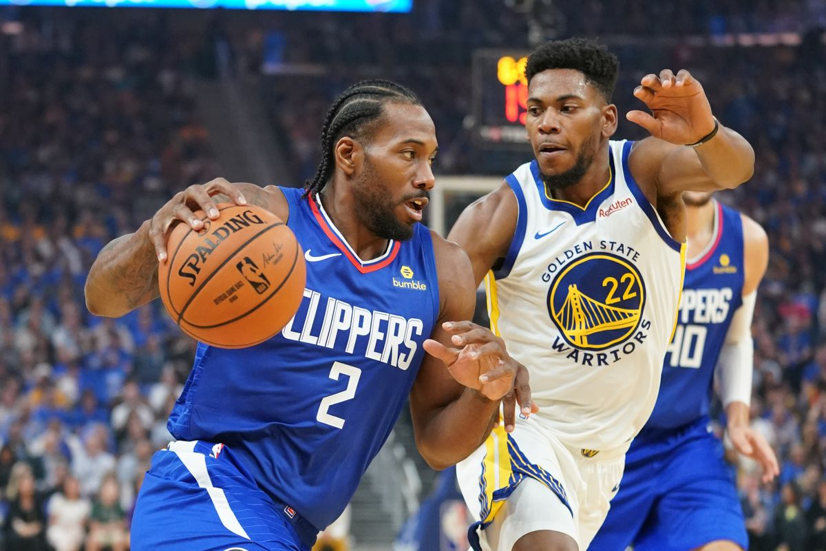 LA Clippers forward Kawhi Leonard dribbles the basketball against Golden State Warriors forward Glenn Robinson III during the first quarter at Chase Center.