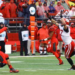 Linebacker Vince Biegel attempts to defelct a pass from Rutgers quarterback Gary Nova.