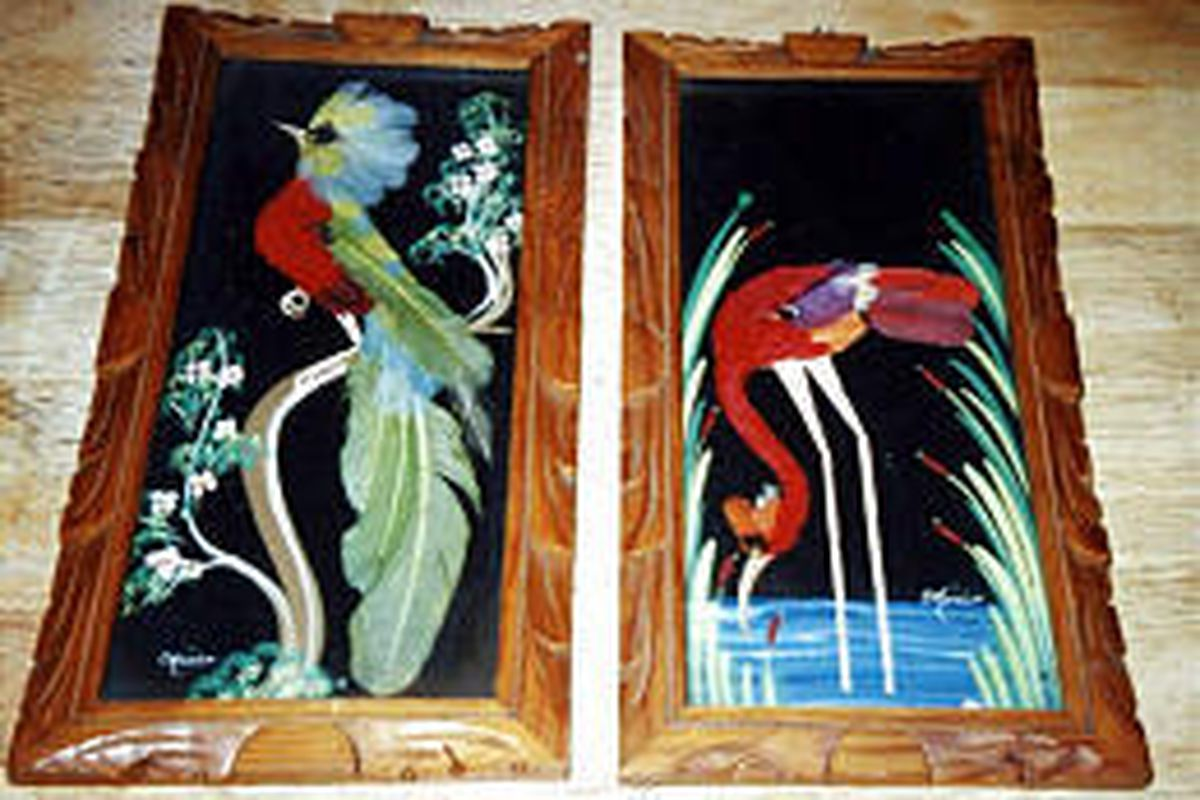Feather-art panels were likely made in Mexico sometime during the mid-20th century. The pair is valued at $100 to $150.