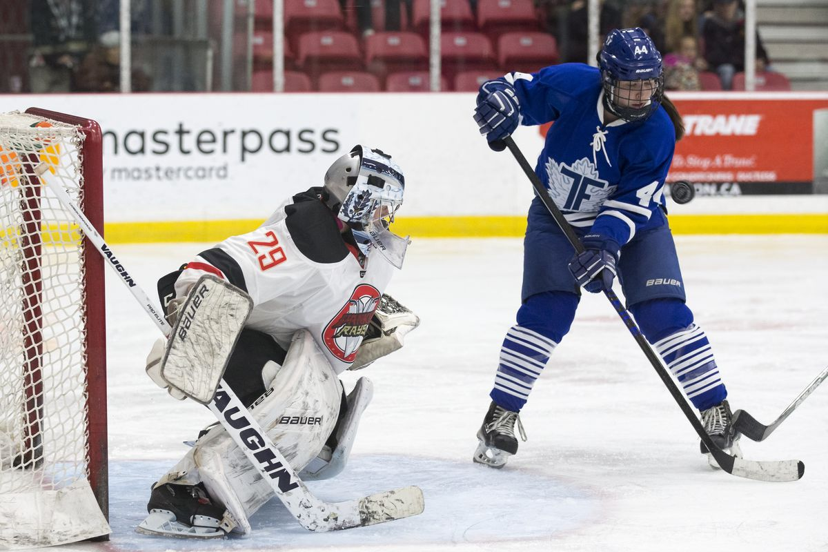 Toronto Furies leading scorer Jenna Dingeldein (44) tries to settle a puck in front of Vanke Rays goalie Elaine Chuli (29)