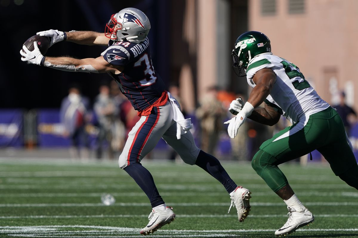 New England Patriots running back Rex Burkhead makes the catch against New York Jets linebacker Frankie Luvu in the fourth quarter at Gillette Stadium.