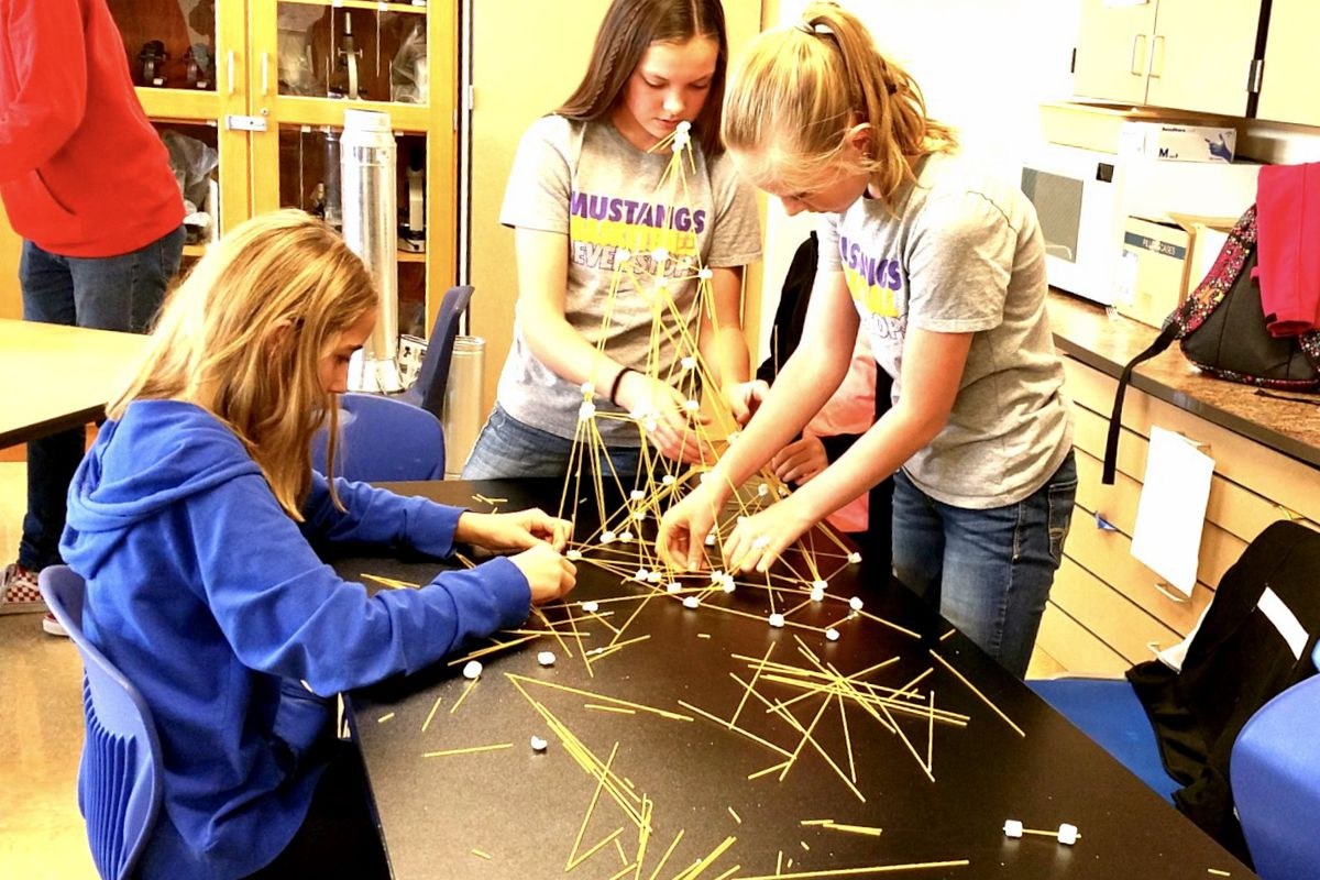 """Students build a marshmallow tower as part of an activity at the Colorado AeroLab in Kremmling. The nonprofit provides a variety of """"fifth-day"""" academic enrichment activities for students attending schools with only four-day weeks."""