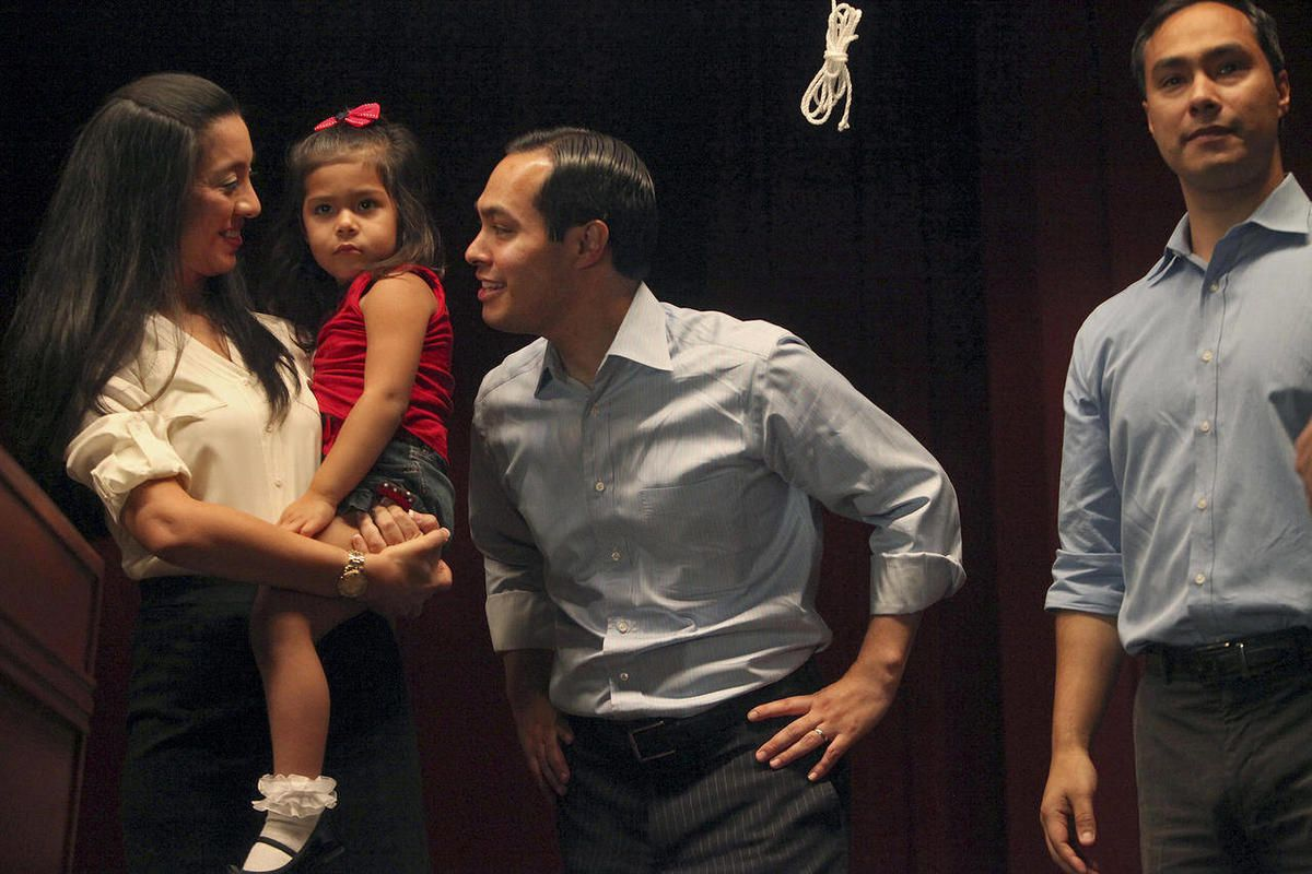 Mayor Julian Castro, center, stands with his wife, Erica Castro, their daughter, Carina, 3, and his brother, Joaquin Castro, right, on stage during the send-off party for their trip to the Democratic National Convention at the St. Paul Community Center in