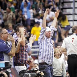 Jazz fans react after Utah Jazz guard Gordon Hayward (20) hit a three pointer as the Utah Jazz and the Orlando Magic play Saturday, April 21, 2012 in Energy Solutions arena.