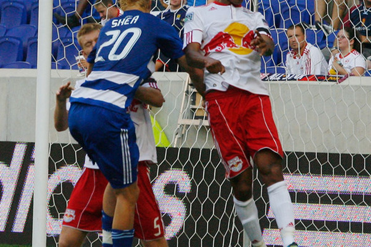 HARRISON, NJ - JULY 23: Roy Miller #7 of the New York Red Bulls heads the ball away from Brek Shea #20 of FC Dallas during the game at Red Bull Arena on July 23, 2011 in Harrison, New Jersey. (Photo by Andy Marlin/Getty Images)
