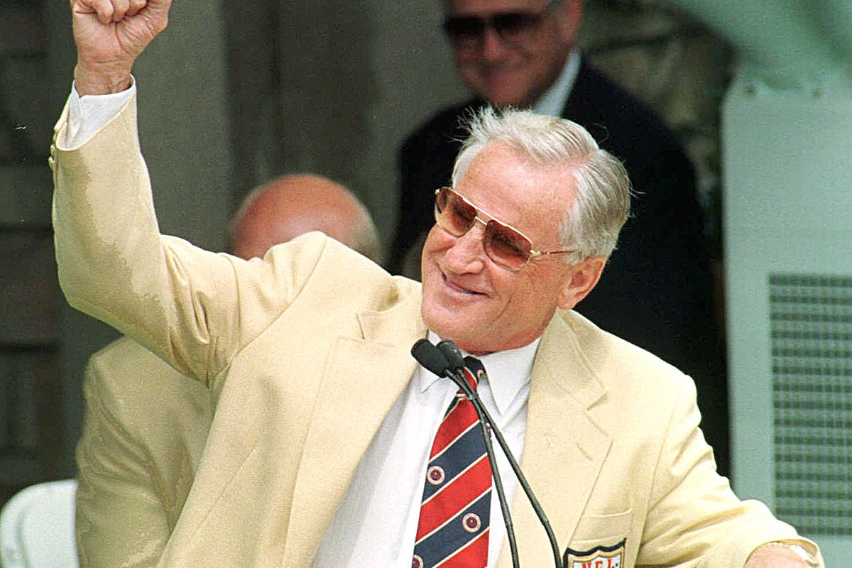 Former Miami Dolphins coach Don Shula gestures to a roaring crowd as he is introduced for enshrinement into the Pro Football Hall of Fame in 1997. The Dolphins announced Shula has died at age 90.