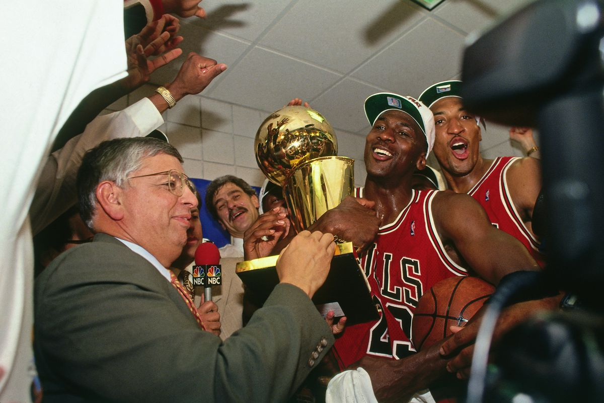 PHOENIX - JUNE 20: NBA Commissioner David Stern presents Michael Jordan and the Chicago Bulls the championship trophy after the Bulls defeated the Phoenix Suns in Game Six of the 1993 NBA Finals on June 20, 1993 at America West Arena in Phoenix, Arizona.
