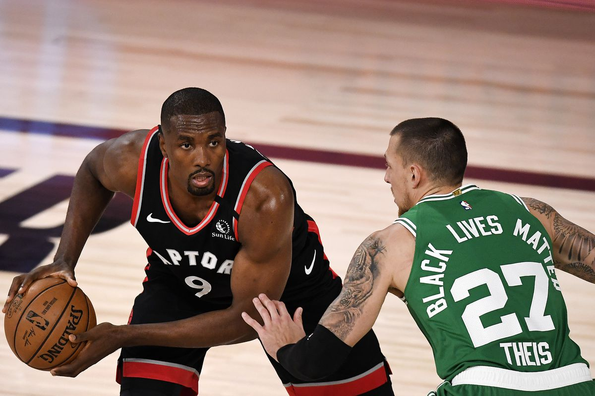 Serge Ibaka of the Toronto Raptors drives the ball against Daniel Theis of the Boston Celtics during the second quarter in Game Three of the Eastern Conference Second Round during the 2020 NBA Playoffs at the Field House at the ESPN Wide World Of Sports Complex on September 03, 2020 in Lake Buena Vista, Florida.