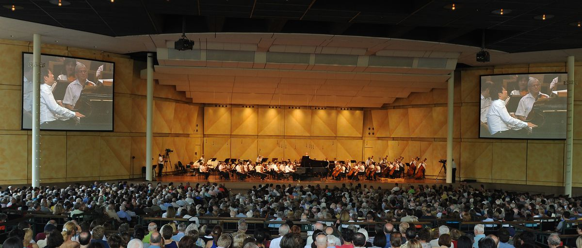 Pianist Lang Lang performs at Ravinia with the Chicago Symphony Orchestra in 2009. The addition of video screens in the pavilion elevated the experience for concertgoers, CEO and president Welz Kauffman says.
