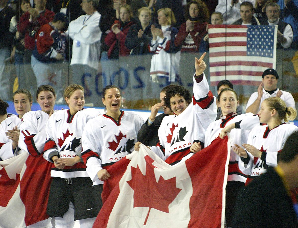 Members of team Canada celebrate after their Women