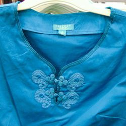 The neck detail on the turquoise dress