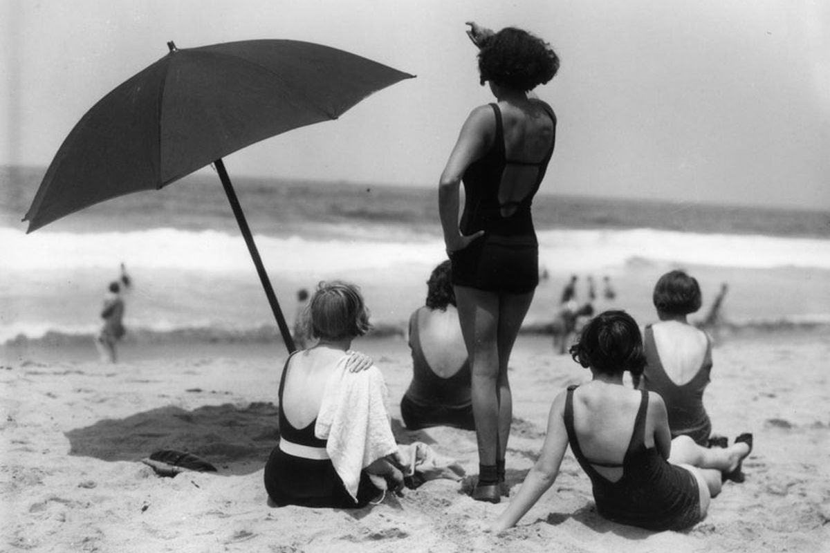 Women at beach in vintage bathing suits