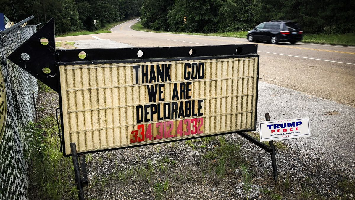 Signs with a political or religious themes are a common sight on the back roads of places like Luverne, Alabama. In this case, a Trump supporter makes a reference to Hillary Clinton.