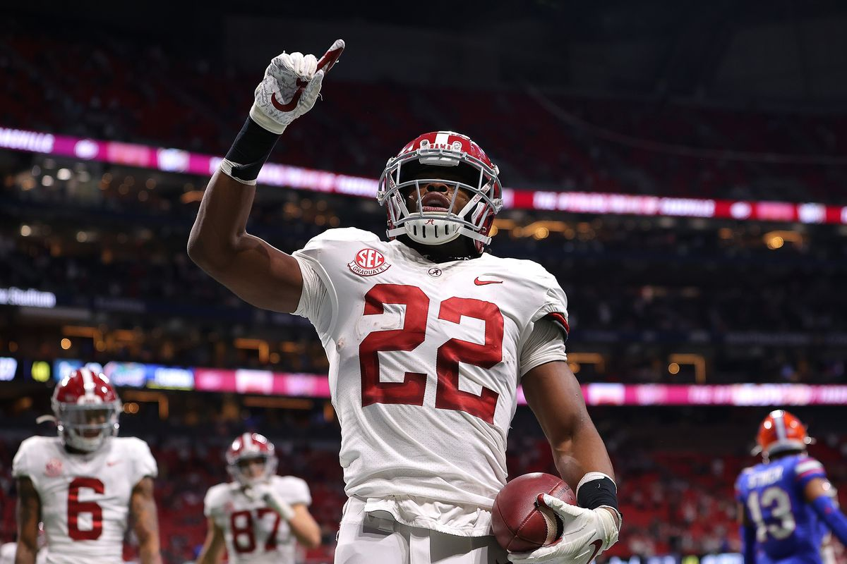 Najee Harris of the Alabama Crimson Tide reacts after rushing for a touchdown against the Florida Gators during the first half of the SEC Championship at Mercedes-Benz Stadium on December 19, 2020 in Atlanta, Georgia.