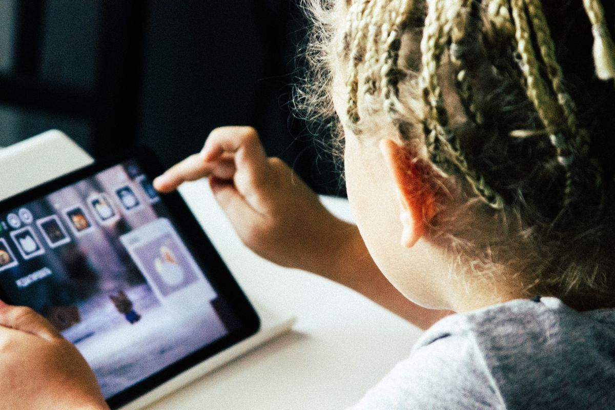 Young girl using a tablet.
