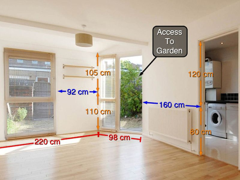The interior of a living area. There are measurements of the walls and other surfaces on the image along with a box with the words: Access to garden.