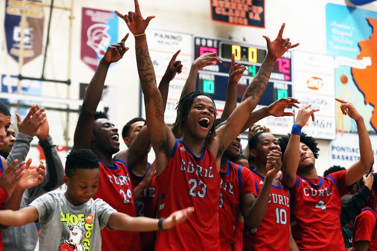 Curie celebrates just before receiving the championship trophy at the Pontiac Holiday Tournament last season.