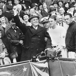 FILE - In this Oct. 5, 1933, file photo, President Franklin D. Roosevelt prepares to throw out the ceremonial first pitch at at Griffith Stadium in Washington, before Game 3 of baseball's World Series between as Washington Senators manager Joe Cronin, third from right, and New York Giants manager Bill Terry, second from right, look on. The President uncorked an almost wild throw that sent the players scrambling. In clinching a playoff spot, the Washington Nationals put the nation's capital in baseball's postseason for the first time in nearly 80 years.