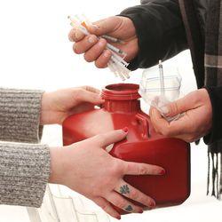 Syringes are handed out during an exchange program in Salt Lake City on Thursday, Dec. 29, 2016. Social worker Mindy Vincent, a former drug addict who is now clean, runs the first syringe exchange program in Utah.