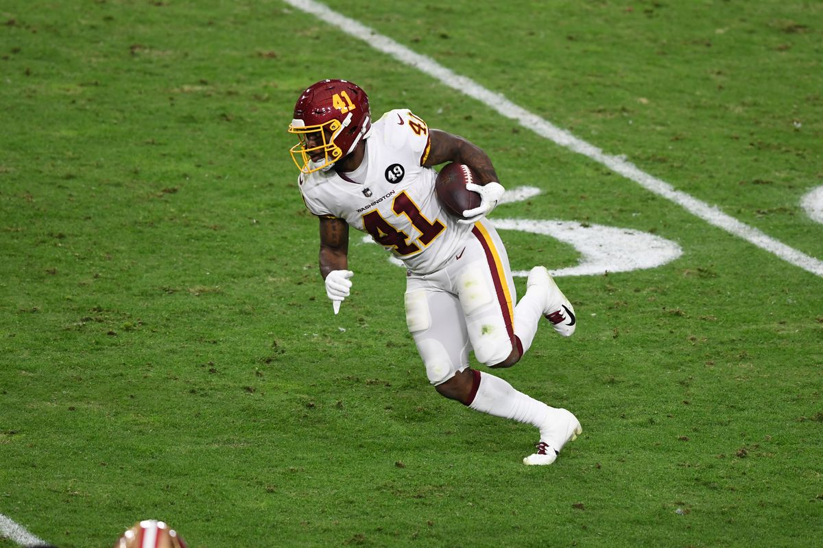 JD McKissic #41 of the Washington Football Team runs with the ball against the San Francisco 49ers at State Farm Stadium on December 13, 2020 in Glendale, Arizona.