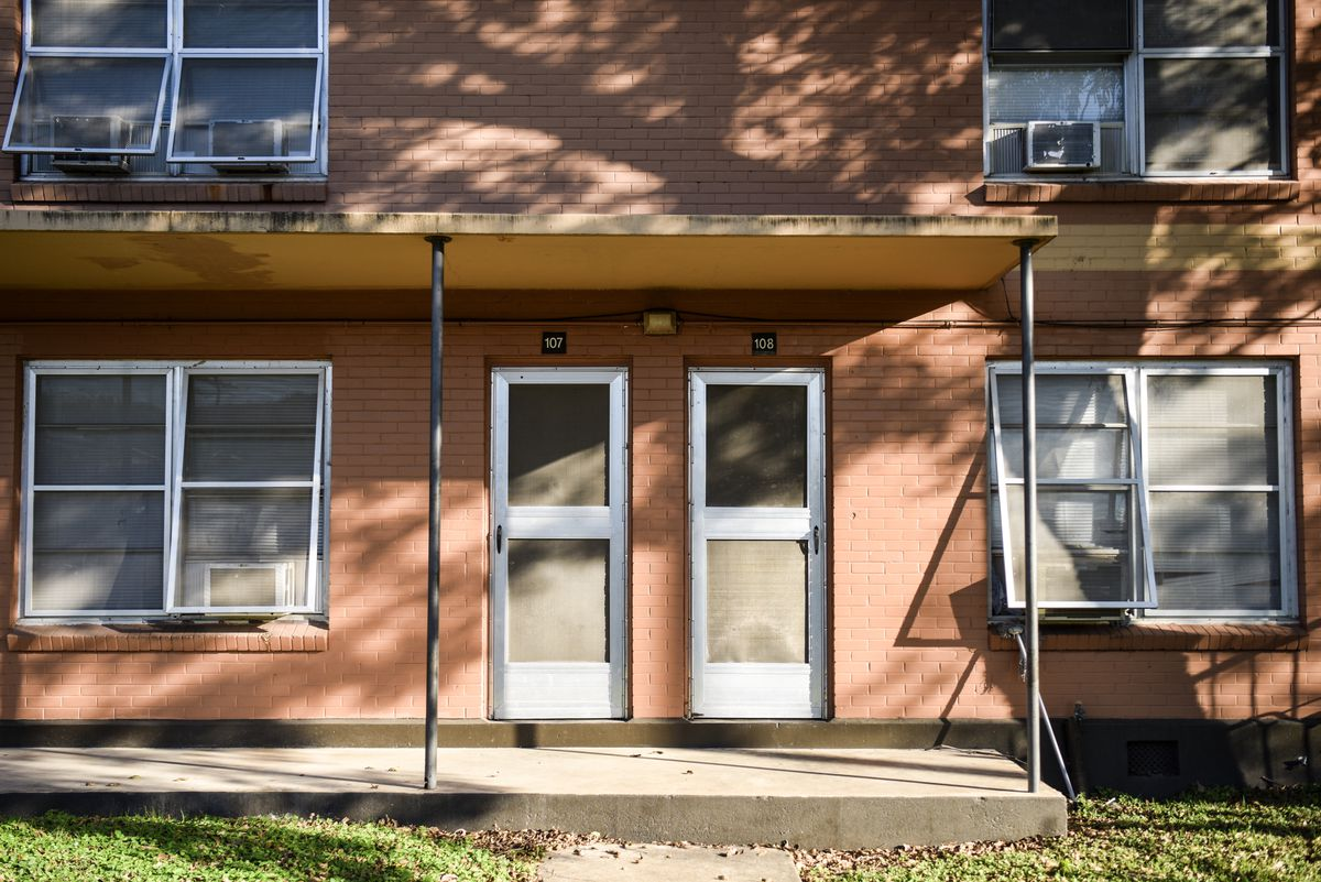 The front doors of two units next to each other at Rosewood Courts.