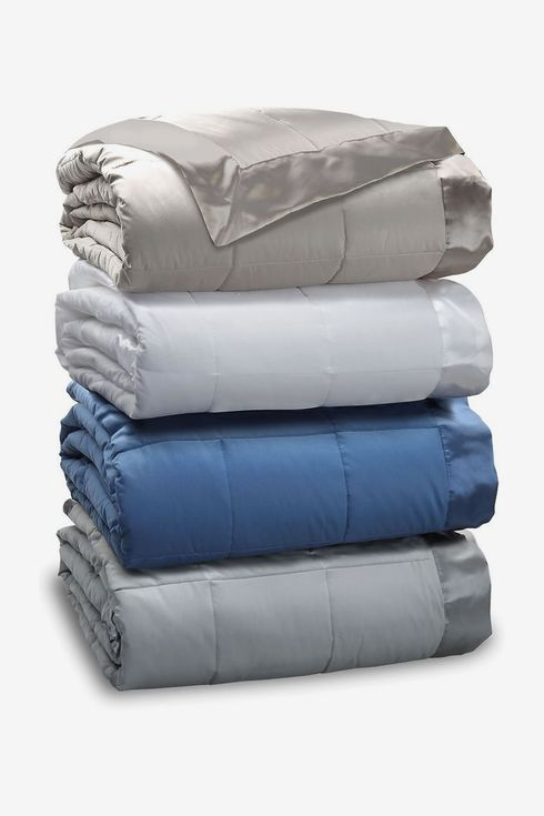 Stack of folded blankets in various colors.