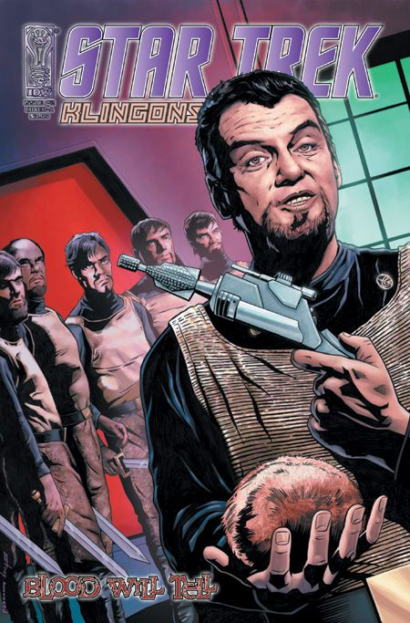 A klingon commander brandishes a gun and a tribble, flanked by his officers, on the cover of Star Trek: Klingons - Blood Will Tell, IDW (2007).