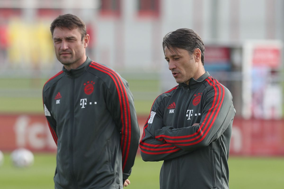 MUNICH, GERMANY - OCTOBER 04: Team coach Niko Kovac (R) of FC Bayern Muenchen and his assistent coach and brother Robert Kovac are pictured during a training session at the club's Saebener Strasse training ground on October 4, 2018 in Munich, Germany.