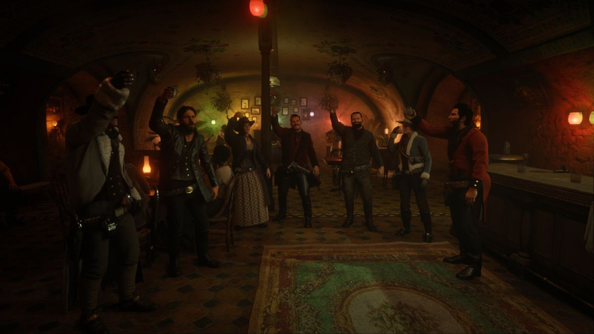 Red Dead Online - a number of cowboys gather in a salon to cheer.  They each hold up a glass of moonlight.