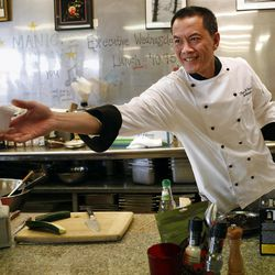 Hai Fitzgerald hands food to a customer at Thyme and Seasons Restaurant in Bountiful on Monday, April 9, 2012.
