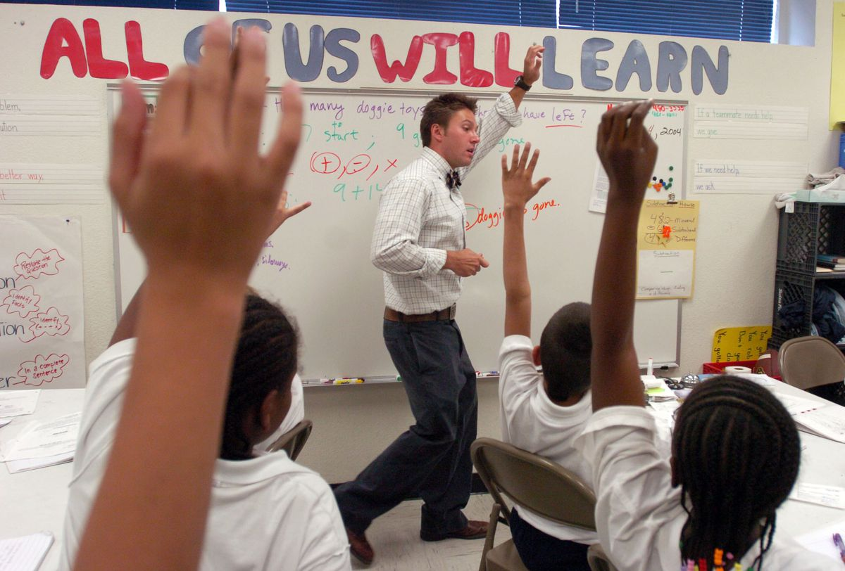 Justin Vernon in 2004 keeps participation and energy levels high in his fifth grade math class at KIPP Sunshine Peak Academy. KIPP was handed Cole Middle School in an attempt to improve the school.