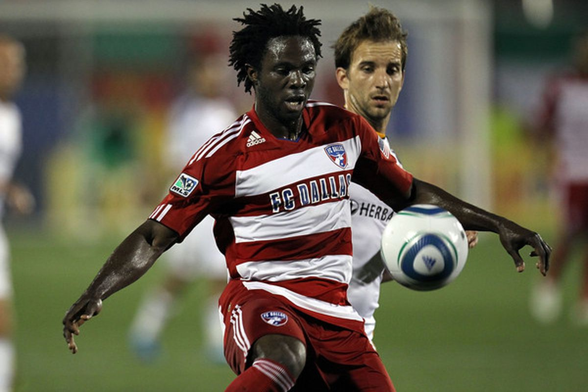 FRISCO, TX - MAY 20:  Defenseman Ugo Ihemelu #3 of FC Dallas dribbles the ball past Mike Magee #18 of the Los Angeles Galaxy at Pizza Hut Park on May 20, 2010 in Frisco, Texas.  (Photo by Ronald Martinez/Getty Images)