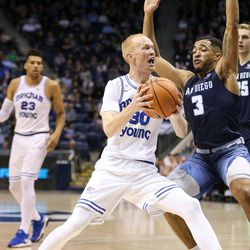 Brigham Young Cougars guard TJ Haws (30) drives against San Diego Toreros guard Olin Carter III (3) at the Marriott Center in Provo on Saturday, Jan. 20, 2018.