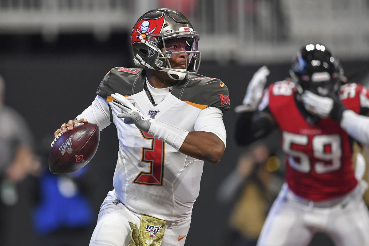Tampa Bay Buccaneers quarterback Jameis Winston looks to throw against the Atlanta Falcons during the first quarter at Mercedes-Benz Stadium.