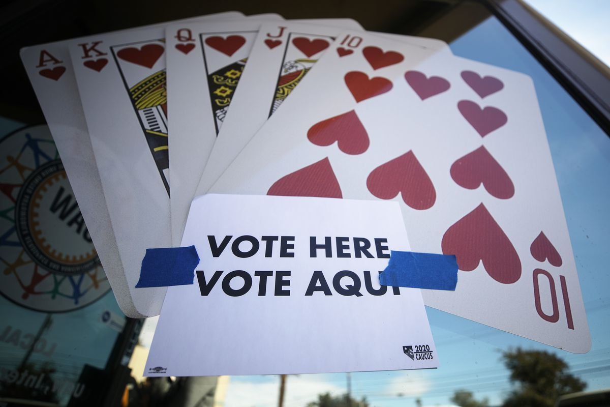 """A """"Vote Here"""" sign marks early voting for the Nevada Democratic presidential caucus."""