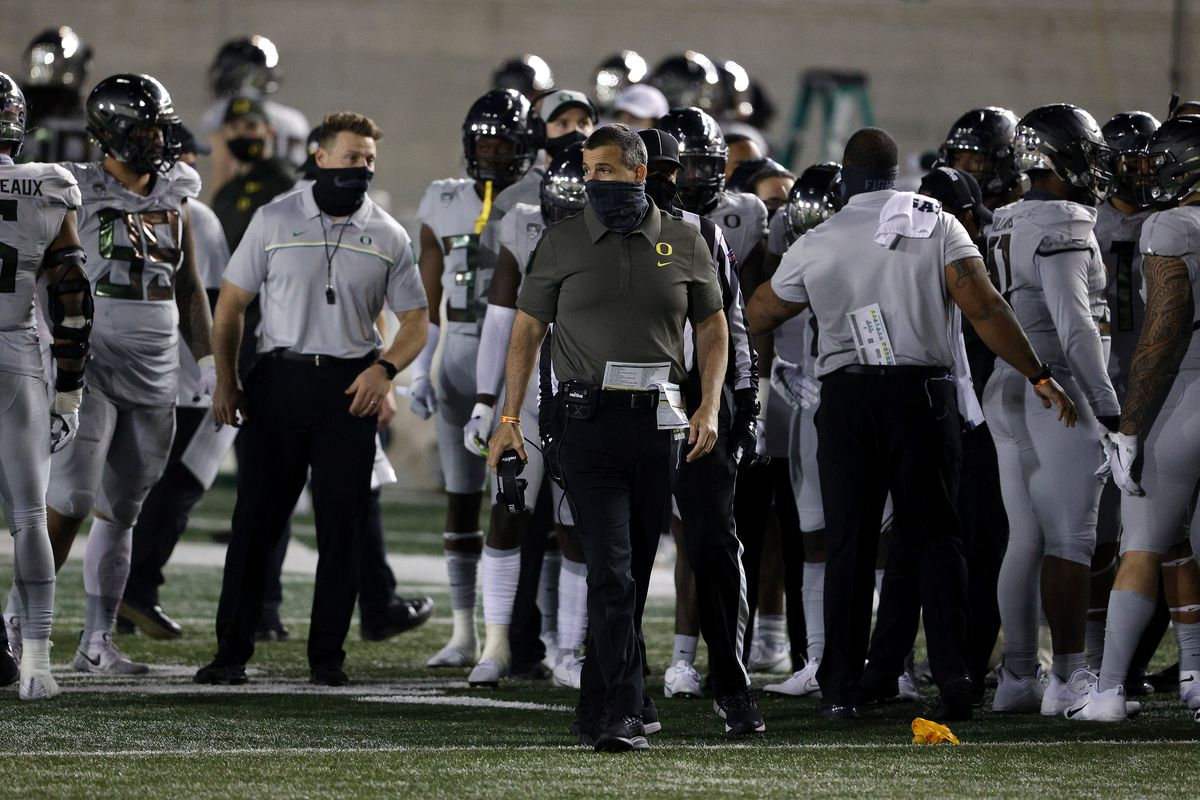 Head coach Mario Cristobal of the Oregon Ducks stands on the side of the field during their game against the California Golden Bears at California Memorial Stadium on December 05, 2020 in Berkeley, California.