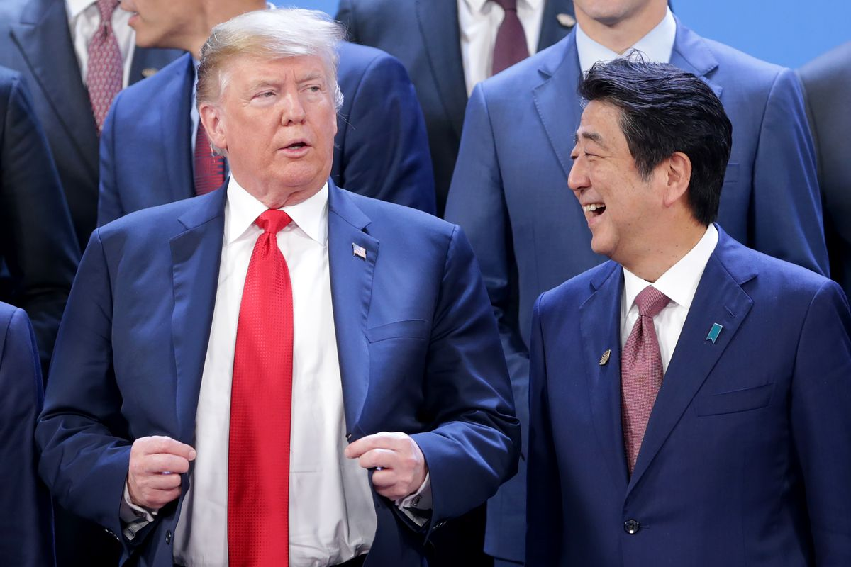 President Donald Trump and Prime Minister of Japan Shinzo Abe talk during the family photo opening day of Argentina G20 Leaders' Summit 2018 at Costa Salguero on November 30, 2018 in Buenos Aires, Argentina.