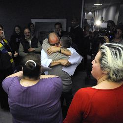 A couple embraces after being married in the Salt Lake County offices after a federal judge ruled that Amendment 3, Utah's same-sex marriage ban, is unconstitutional on Friday, Dec. 20, 2013.